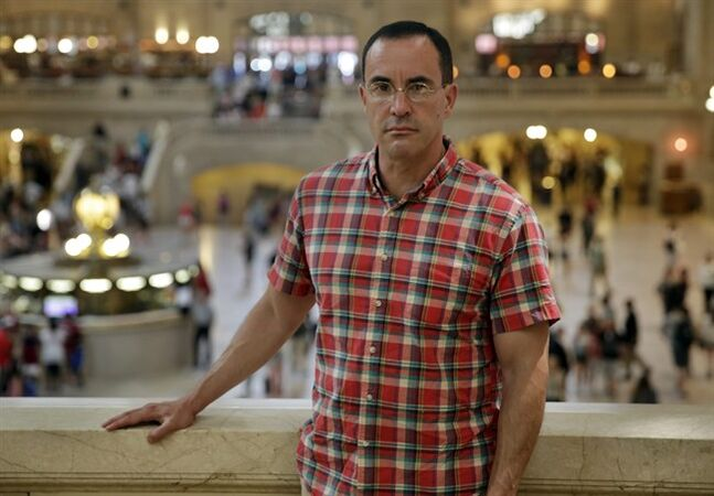In this July 22, 2014 photo, AIDS activist Gregg Gonsalves poses for photos in New York's Grand Central Terminal. In the early 1990s, Gonsalves traveled to Washington to confront, provoke and challenge officials at the Food and Drug Administration. A quarter century later, he still travels to Washington, but with a very different agenda: to defend the FDA. (AP Photo/Richard Drew)