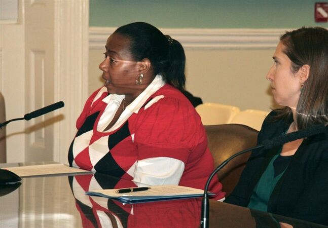 In this Dec. 12, 2013 photo provided by A Better Balance, caregiver Dena Adams, left, accompanied by attorney Phoebe Taubman, testifies before the New York City Council Civil Rights Committee. If you don't get a job because you're a woman, or you get fired because you're black, or you get put on a bad shift because you're gay, there's a law for that. But if you're punished at work because you need time to talk to your kid's teacher on the phone or take your elderly mother to the doctor, you might be out of luck. In most places around the country, advocates say, there's no explicit protection against employment discrimination based on a worker's status as a caregiver. A pending bill in New York City aims to plug that hole. (AP Photo/A Better Balance)