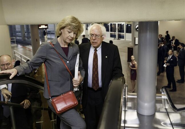 Senate Veterans Affairs Committee Chairman Sen. Bernie Sanders, I-Vt., right, speaks with Sen. Tammy Baldwin, D-Wis. as they take an escalator to the Senate on Capitol Hill in Washington, Wednesday, June 4, 2014. Sanders proposed legislation this week that would allow veterans who can't get timely appointments with VA doctors to go to community health centers, military hospitals or private doctors. The bill also would authorize the VA to lease 27 new health facilities in 18 states and give the VA secretary authority to remove senior executives within 30 days of being fired for poor job performance, eliminating lengthy appeals. (AP Photo/J. Scott Applewhite)