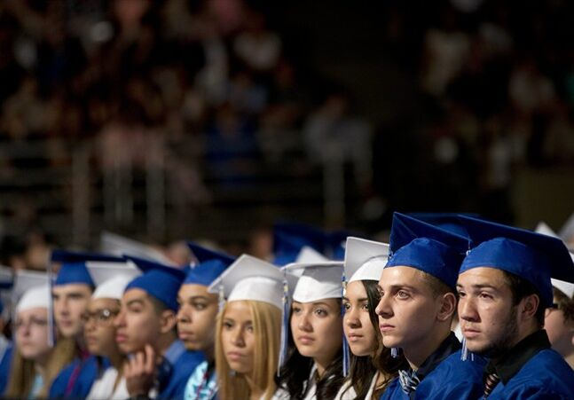 Members of the class of 2014 listen to President Barack Obama deliver the commencement address for Worcester Technical High School, Wednesday, June 11, 2014, in Worcester, Mass. (AP Photo/Pablo Martinez Monsivais)