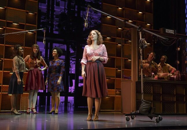 This image released by The O and M Company shows Jessie Mueller as Carole King, center, in