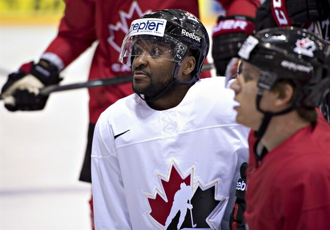Team Canada Joel Ward, left, listens to the coach with teammate Brayden Schenn during practice Tuesday, May 13, 2014 at the IIHF World Hockey Championship in Minsk, Belarus. THE CANADIAN PRESS/Jacques Boissinot