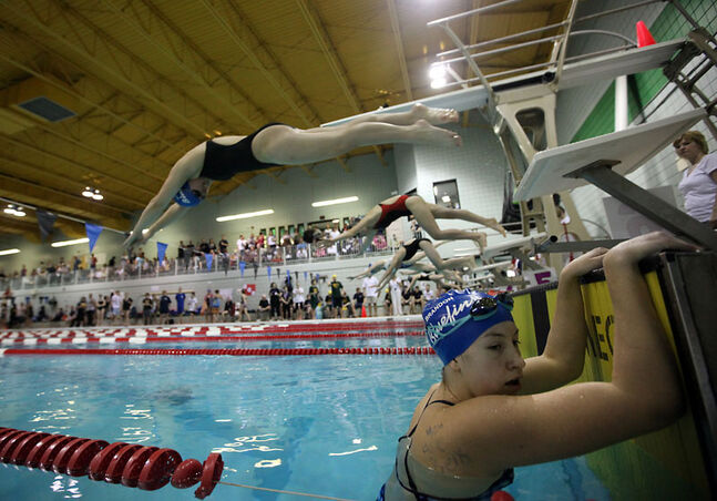 Swimmers compete at an event in 2010 at Brandon's six-lane Sportsplex Pool. Swimming Canada wants athletes to compete in an eight-lane pool at the 2017 Canada Summer Games.