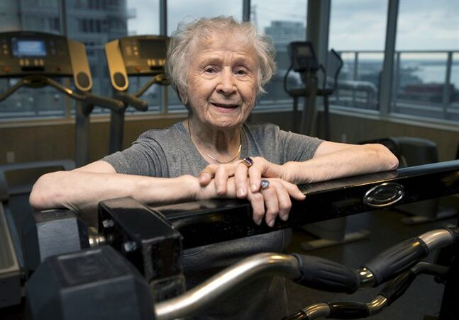 Olga Kotelko poses in Toronto on Wednesday, January 15, 2014. Kotelko, one of Canada's most accomplished track and field athletes with dozens of world records and medals to her credit, has died. She was 95. THE CANADIAN PRESS/Frank Gunn