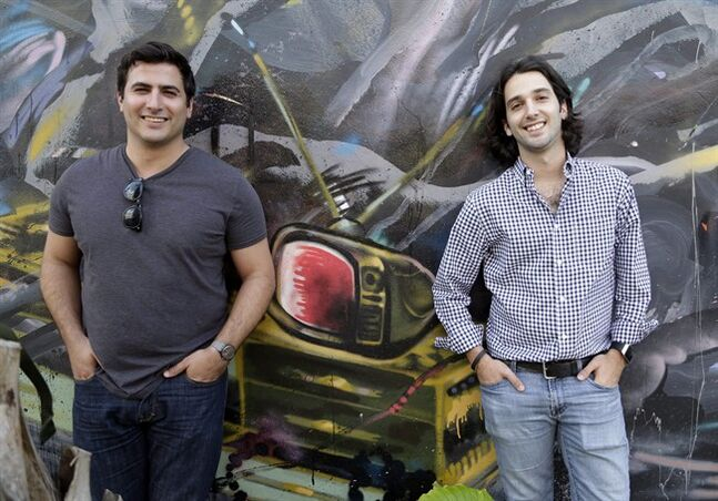 "In this Thursday, April 10, 2014 photo, Wifredo Fernandez, left, and Daniel Lafuente, co-founders of a new tech focused collaborative space called The LAB Miami, pose for a photo at The LAB Miami in the Wynwood Arts District of Miami. Entrepreneurs such as Lafuente and Fernandez are betting on rapid growth across Latin America to draw in both startups and investors, as well as Miami's ""frontier mentality"" when it comes to business and reinvention. (AP Photo/Wilfredo Lee)"