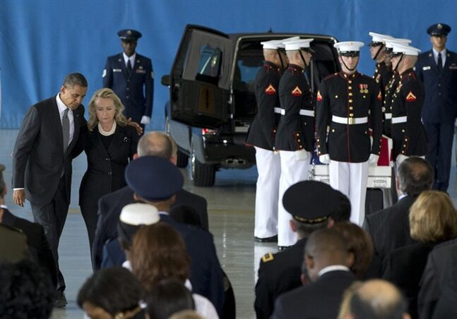 FILE - In this Sept. 14, 2012 file photo, President Barack Obama and Secretary of State Hillary Rodham Clinton walk back to their seats during the Transfer of Remains Ceremony at Andrews Air Force Base, Md., marking the return to the United States of the remains of the four Americans in Benghazi, Libya. Newly revealed testimony from top military commanders involved in the U.S. response to the Benghazi attacks suggests that the perpetrators of a second, dawn attack on a CIA complex probably were different from those who penetrated the U.S. diplomatic mission the evening before and set it ablaze, killing Ambassador Chris Stevens and another American. The second attack, which killed two security contractors, showed clear military training, retired Gen. Carter Ham told Congress in closed-door testimony. (AP Photo/Carolyn Kaster)