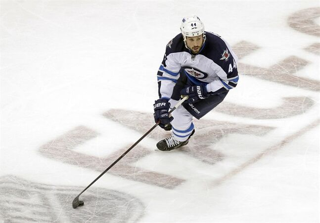 Winnipeg Jets' Zach Bogosian skates against the Minnesota Wild on Oct. 10, 2013, in St. Paul, Minn. THE CANADIAN PRESS/AP, Jim Mone