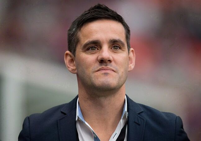 Canada's national women's soccer team head coach John Herdman watches his players warm up before an international friendly soccer game against Mexico in Vancouver, B.C., on Sunday November 24, 2013. Herdman says Canada isn't good enough to win the Women's World Cup right now, but the team's head coach adds it