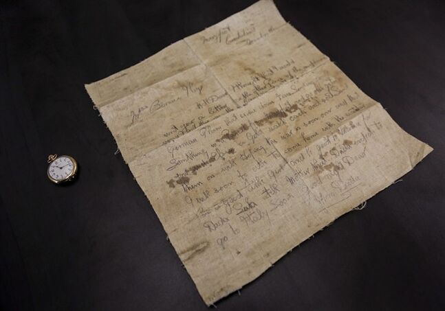 University of Calgary Student Mike Hilton found a letter written by his great-grandfather during World War I that was written on fabric from a German aircraft his unit had shot down. The letter was written on March 12, 1918 and was displayed by Hilton at The Military Museums in Calgary, Alta., Friday, July 25, 2014. The battlefield letter is part of an exhibit marking the centennial of the First World War. THE CANADIAN PRESS/Jeff McIntosh
