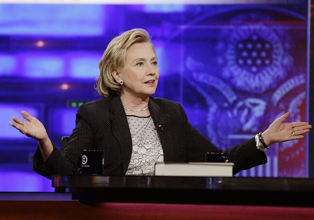 Former U.S. Secretary of State Hillary Rodham Clinton gestures while speaking to host Jon Stewart during a taping of