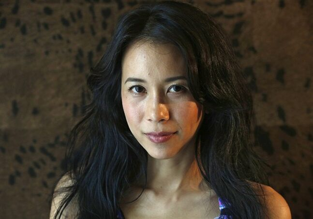 "In this Jan. 31, 2013 photo, Hong Kong actress Karen Mok poses during an interview at a hotel in Hong Kong. Mok wrestles with what's been a life-long question for her on the title of her first English album, ""Somewhere I Belong."" The Hong Kong pop diva has a half-Chinese, half-Welsh father and her mother is half-Chinese, one quarter-Iranian and a quarter-German. It's easy to see why Mok cannot pinpoint one ethnic identity. (AP Photo/Vincent Yu)"