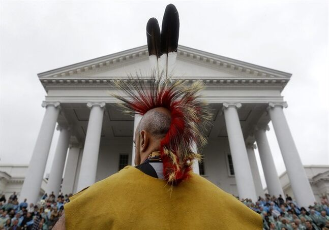 A member of one of Virginia's 11 Native American tribes performs a blessing dance in honor of Virginia Gov. Terry McAuliffe during inaugural ceremonies at the Capitol in Richmond, Va., Saturday, Jan. 11, 2014. McAuliffe took the oath of office to become the 72nd governor of Virginia. (AP Photo/Patrick Semansky)