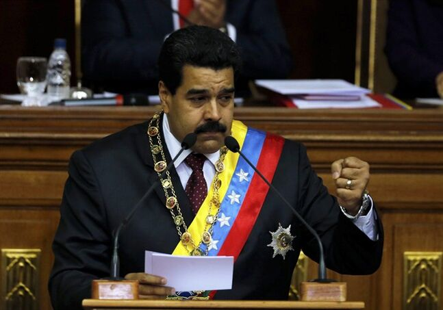 Venezuela's President Nicolas Maduro speaks during his annual state-of-the-nation address to the National Assembly in Caracas, Venezuela, Wednesday, Jan. 15, 2014. (AP Photo/Fernando Llano)