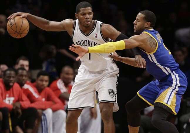 Golden State Warriors' Andre Iguodala (9) guards Brooklyn Nets' Joe Johnson (7) Wednesday, Jan. 8, 2014, in New York. THE CANADIAN PRESS/AP, Frank Franklin II