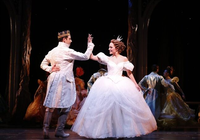FILE - This image released by Sam Rudy Media Relations shows Laura Osnes as Cinderella, right, dancing with Santino Fontana as the Prince, during a performance of