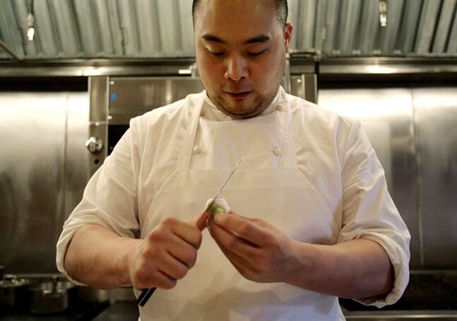 This April 9, 2008 file photo shows chef David Chang preparing vegetables for dinner at Momofuku Ko in New York. THE CANADIAN PRESS/AP, Seth Wenig
