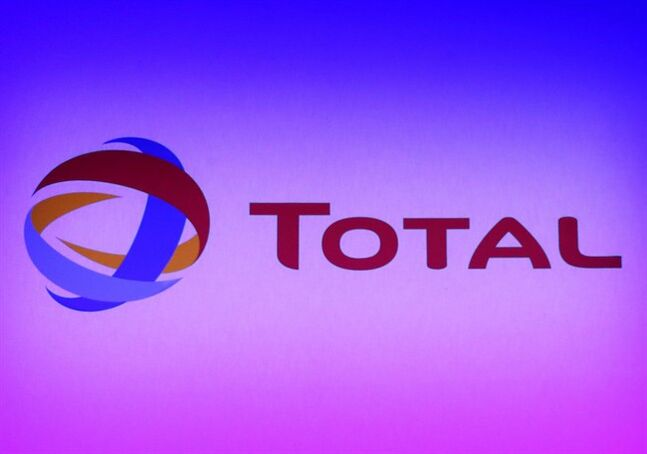 The logo of French energy giant Total, is projected in Paris on Feb. 13, 2013. THE CANADIAN PRESS/AP, Jacques Brinon