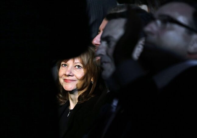 FILE - In this Monday, Jan. 13, 2014, file photo incoming General Motors CEO Mary Barra watches the North American Truck of the Year and Car of the Year awards at the North American International Auto Show in Detroit. General Motors reports quarterly earnings on Thursday, Feb. 6, 2014 (AP Photo/Paul Sancya)