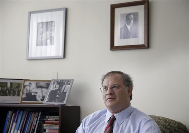 In this July 9, 2014 photo, economist David Levy poses for picture in his office in Mt. Kisco, N.Y. Levy, who oversees the Levy Forecast, a newsletter analyzing the economy that his family started in 1949, says the United States is likely to fall into a recession next year triggered by downturns in other countries, the first time in modern history. (AP Photo/Seth Wenig)