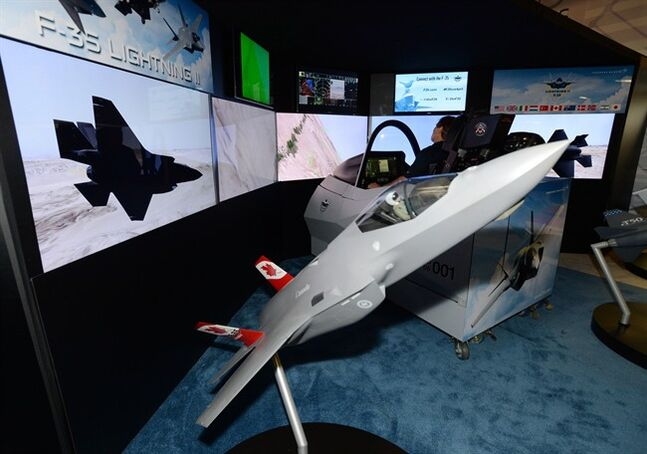 Lockheed Martin displays an F-35 simulator at the CANSEC trade show in Ottawa on Wednesday, May 28, 2014. THE CANADIAN PRESS/Sean Kilpatrick