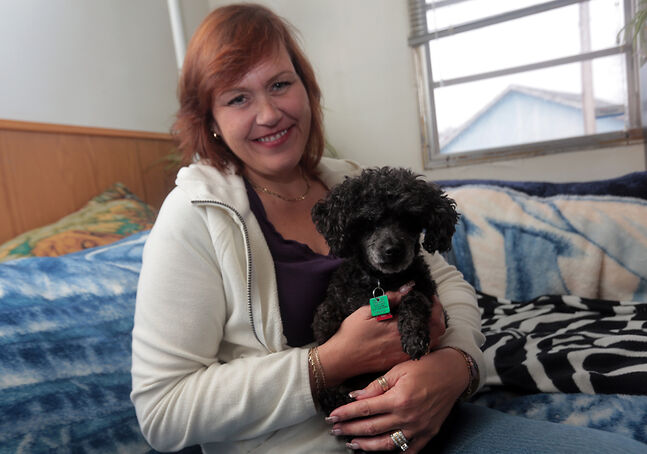 Leanne Hermary Fortune has been reunited with her teacup poodle LJ, who turned up 130 kilometres from Brandon after her Jeep was ransacked a week earlier.