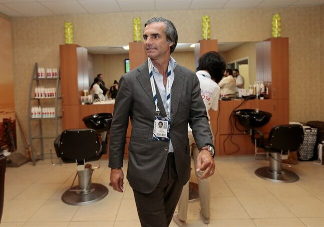 In this photo taken on Wednesday, Sept. 3, 2014, Julien Farel walks through the hair salon for players inside Arthur Ashe Stadium at the Billie Jean King National Tennis Center during the 2014 U.S. Open tennis tournament in New York. For eight straight U.S. Opens, Farel has been the tournament's official hairstylist, operating the pop-up salon in the inner sanctum of Arthur Ashe Stadium that offers manicures, pedicures, makeup and, of course, cuts, styles and braids for every participant in the tournament, free of charge. (AP Photo/Julio Cortez)