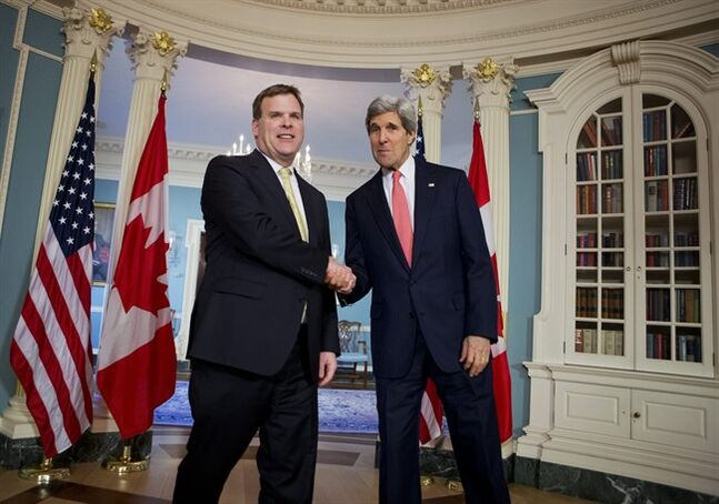 Secretary of State John Kerry shakes hands with Canadian Foreign Minister John Baird at the State Department in Washington, Friday, Jan. 17, 2014. (AP Photo/Manuel Balce Ceneta)
