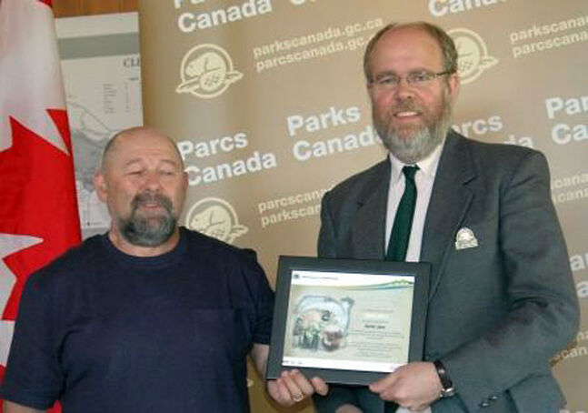 RMNP superintendent Robert Sheldon (right) presents the Parks Canada Ambassador for Education Award to David Juce, lead teacher on the Park West School Division Outdoor Education Pilot Project Team.