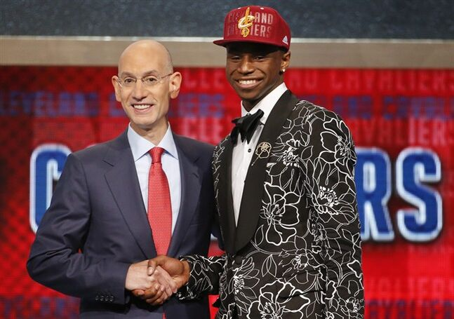 NBA Commissioner Adam Silver, left, congratulates Canada's Andrew Wiggins, of Kansas, who was selected by the Cleveland Cavaliers as the number one pick in the 2014 NBA draft, Thursday, June 26, 2014, in New York. (AP Photo/Jason DeCrow)