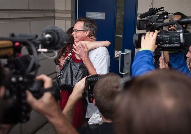 Marc Emery receives a hug from his wife Jodie at the border crossing in Windsor, Ontario, Tuesday, August 12, 2014. Canada's self-styled