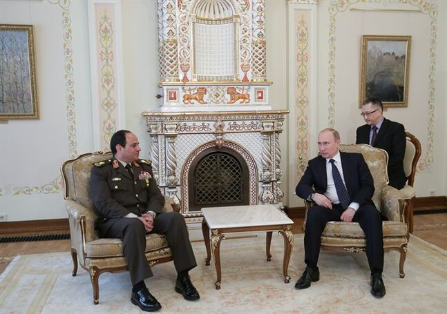 Russian President Vladimir Putin, right, speaks with Egypt's military chief Field Marshal Abdel-Fattah el-Sissi in the Novo-Ogaryovo residence outside Moscow on Thursday, Feb. 13, 2014. Russian President Vladimir Putin on Thursday wished Egypt's military chief victory in the nation's presidential vote as Moscow sought to expand its military and other ties with a key U.S. ally in the Middle East. (AP Photo/RIA Novosti, Mikhail Metzel, Presidential Press Service)