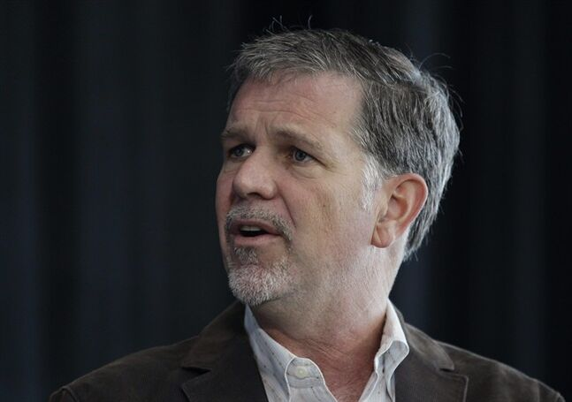 FILE - In this Aug. 2, 2011, file photo, Netflix CEO Reed Hastings speaks at a meeting in Palo Alto, Calif. Netflix Chairman and CEO Hastings is getting a 50 percent pay bump in 2014 after a year in which shares of the online video subscription company quadrupled to an all-time high. (AP Photo/Paul Sakuma, File)