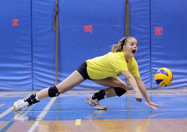 Brandon's Jessi Coulter, a provincial team member, dives for a ball during the Brandon University Bobcats Elite Volleyball Camp at the BU gymnasium in 2011.