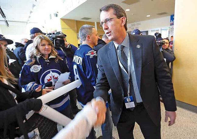 Team owner Mark Chipman greets fans in the MTS Centre foyer before the start of the Winnipeg Jets game versus the Ottawa Senators Saturday.