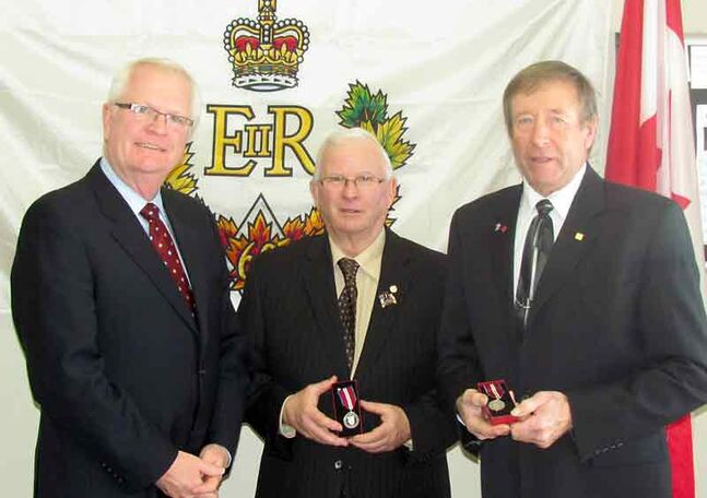 Brandon-Souris Conservative MP Merv Tweed (left) presents Queen's Diamond Jubilee Medals to Bob McCallum (middle) and Edward Anderson on Tuesday.