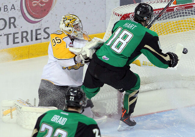 Prince Albert's Jayden Hart scores in the first period as Brandon goalie Curtis Honey gets caught behind the net.