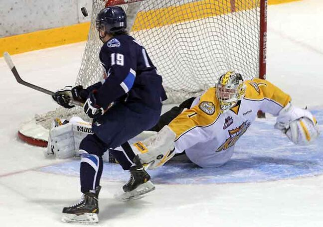Blades forward Brenden Walker fails to beat Wheat Kings netminder Corbin Boes on a first-period breakaway.