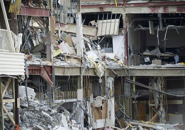 Collapsed rubble is seen at the Algo Centre Mall in Elliot Lake, Ont., on Wednesday, June 27, 2012, after the mall's roof collapsed. A hearing into the collapse begins Monday as a public inquiry delves into the tragedy that killed two women and left a community bereft. THE CANADIAN PRESS/Nathan Denette