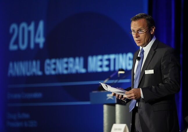 Doug Suttles, president and CEO of Encana, addresses the company's annual meeting in Calgary, Tuesday, May 13, 2014. THE CANADIAN PRESS/Jeff McIntosh