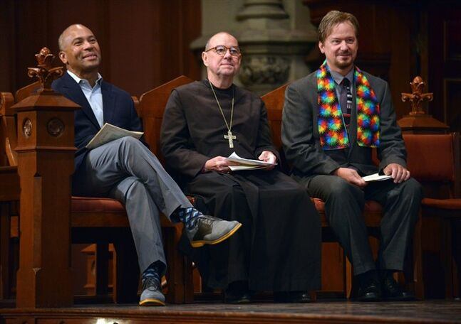 In this June 14, 2014 photo, Massachusetts Gov. Deval Patrick, left, Rev. M. Thomas Shaw, center, and Frank Schaefer, look on during a ceremony where the three were to receive Open Door Awards for their public advocacy at a service marking 10 years of legal gay marriage in Massachusetts, at Old South Church, in Boston. Schaefer, a Methodist pastor who was defrocked for officiating his gay son's wedding, accepted the award the weekend before a Methodist judicial panel was scheduled to hear his appeal to continue in the ministry. (AP Photo/Josh Reynolds)