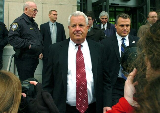FILE - In this Feb. 12, 2009 file photo, Michael Conahan, center, leaves the federal courthouse in Scranton, Pa. The film