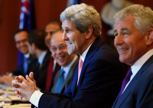 U.S. Secretary of State John Kerry, second from right, along with U.S. Secretary of Defense Chuck Hagel, right, addresses the start of the Australia-US Ministerial Consultations (AUSMIN) talks at Admiralty House in Sydney, Tuesday, Aug. 12, 2014. Kerry and Hagel are meeting with their Australian counterparts at the annual AUSMIN, which will focus on regional security and enhanced military co-operation. (AP Photo/Dan Himbrechts, Pool)