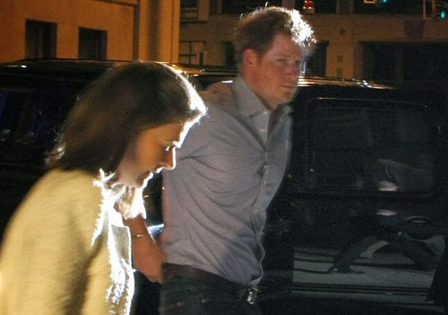 "In this Thursday May 1, 2014, photo, Britain's Prince Harry steps out of a vehicle to eat at Rendezvou in downtown Memphis, Tenn. Prince Harry and Prince William are visiting Memphis for the Saturday wedding of former Memphian Elizabeth ""Lizzy"" Wilson and London nightclub owner Guy Pelly. (AP Photo/The Commercial Appeal, Karen Pulfer Focht)"