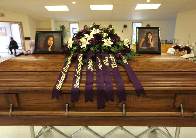 Tina Fontaine's photographs sit on top of her casket surrounded by  flowers and items in the colour purple, her favourite colour. She had been caught in a net of drugs, alcohol and violence before she disappeared.