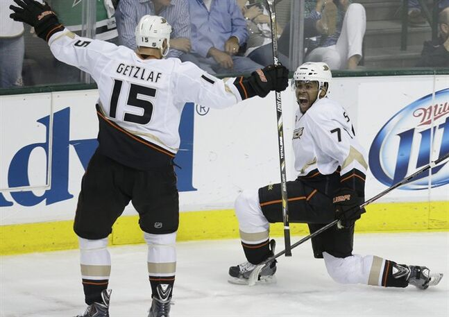 Anaheim Ducks right wing Devante Smith-Pelly (77) celebrates with his teammate Ryan Getzlaf (15) after Smith-Pelly scored a goal during the third period of Game 6 of a first-round NHL hockey playoff series against the Dallas Stars in Dallas, Sunday, April 27, 2014. (AP Photo/LM Otero)
