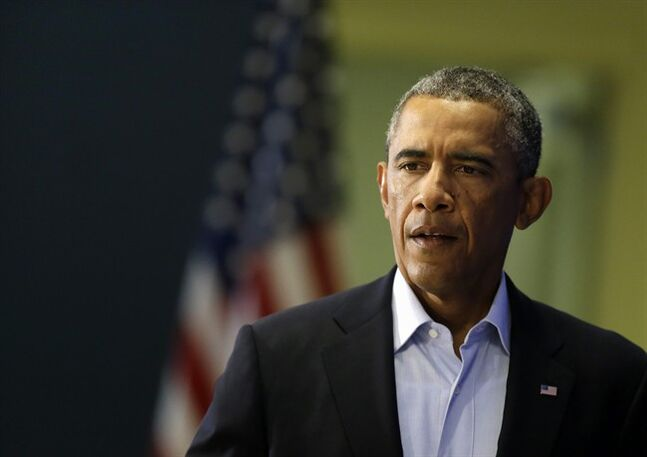 President Barack Obama approaches a podium in Edgartown, Mass., Wednesday, Aug. 20, 2014, to address members of the media about the killing of American journalist James Foley by militants with the Islamic State extremist group. The president said the US will continue to confront Islamic State extremists despite the brutal murder of journalist James Foley. Obama said the entire world is