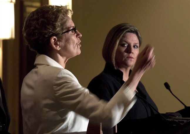Ontario Liberal Leader Kathleen Wynne, left, and Ontario NDP Leader Andrea Horwath participate in the Northern Leader's Debate in Thunder Bay, on Monday, May 26, 2014. THE CANADIAN PRESS/Frank Gunn