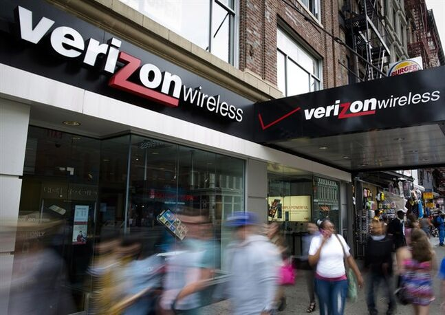 Pedestrians pass a Verizon Wireless store on Canal Street in New York on June 6, 2013. THE CANADIAN PRESS/AP, John Minchillo