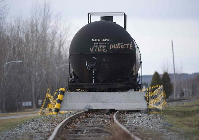 A rail car rests on a track in the town of Lac Megantic, Que. Rail traffic is set to resume in Lac-Megantic on Wednesday, five months after a runaway train carrying crude oil derailed, exploded and killed 47 people.