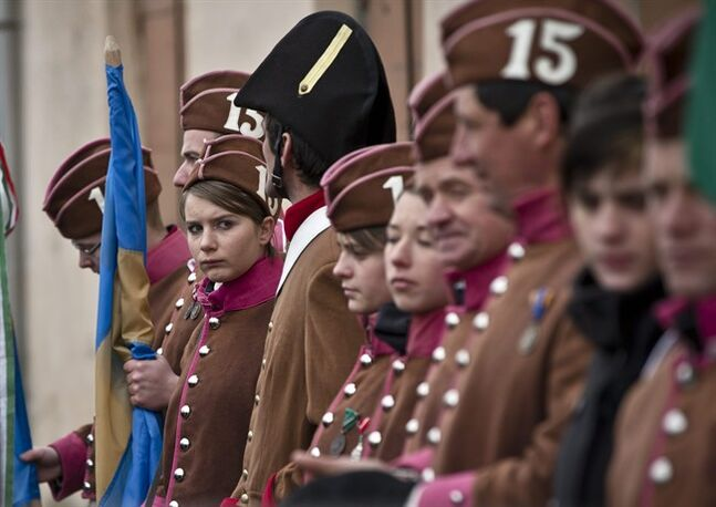 Ethnic Hungarians wear vintage uniforms during celebrations in Targu Secuiesc, Romania, Friday, March 15, 2013. Thousands of ethnic Hungarians paraded in Romania Friday to celebrate the Hungarian national holiday, calling for their minority to keep the broad autonomy it has long enjoyed. They were whipped by winds with temperatures plunging to an icy -4 Celsius (25 Fahrenheit) as they celebrated the anniversary of the 1848 revolution against the Habsburg empire. (AP Photo/Vadim Ghirda)
